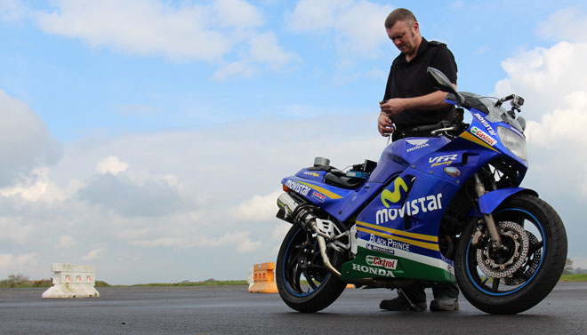 Shaun McKeown setting the VBOX up on a motorcycle to gain acceleration parameters